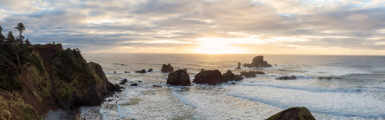 Panoramic Seascape view of a Beautiful Pacific Ocean Coast with a rugged rocky formation. Taken in Ecola State Park, Seaside, Cannon Beach, Oregon, USA.