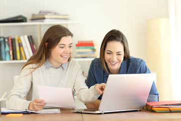 Two students learning together on line