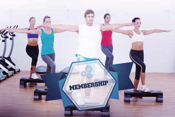 The word membership and fitness class performing step aerobics exercise against hexagon