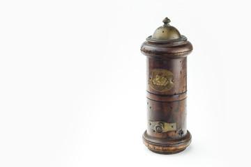Detail of salt shaker or saltbox in white background