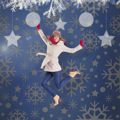 Happy blonde in winter clothes posing against blue vignette