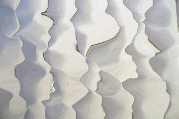 Abstract white and gray vertical bumps