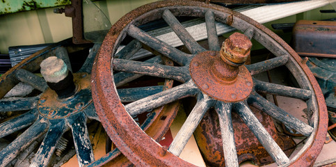 Wooden spoked wheels laying in a pile