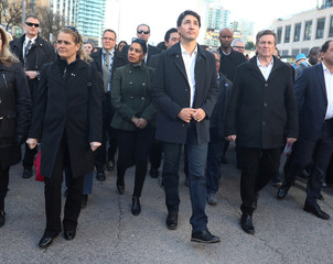 Canada's Prime Minister Justin Trudeau, Governor General Julie Payette and Toronto Mayor John Tory walk with crowds down Yonge Street in Toronto to vigil.