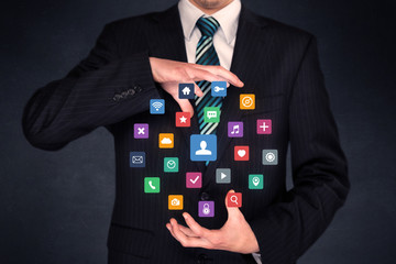 Colorful multimedia icons in the hands of a businessman