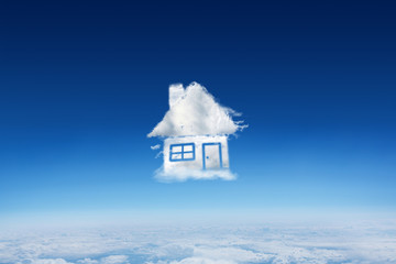 Cloud house against blue sky over clouds at high altitude