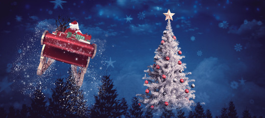 Santa flying his sleigh against night sky over forest with christmas tree