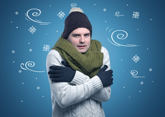 Young hipster frozen boy with doodled snowflakes and windy concept