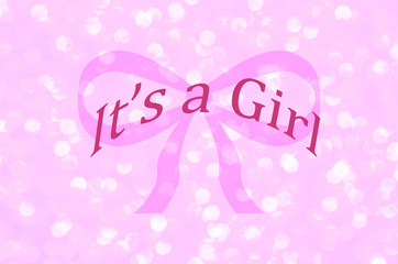 It's a girl, announcement message over pink ribbon with sparkle light pink background. Celebrate welcoming baby girl.  Gender reveal, baby shower, birth announcement or baptism.