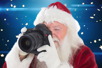 Santa is taking a picture against bright star pattern on blue