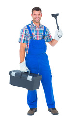 Portrait of happy plumber with plunger and toolbox