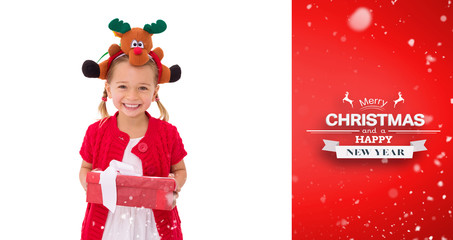 Cute little girl wearing rudolph headband against red vignette