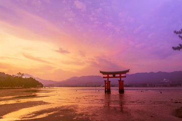 Torii Gate of Itsukushima Shrine on sunset time at Miyajima, Hiroshima, Japan
