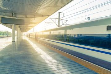 Railway station platform and train