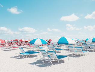 View of beach umbrellas and lounge chairs