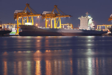 large container boat approaching on commercial port for loading container box