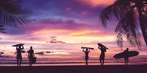 Silhouette of surfer people carrying surfboard