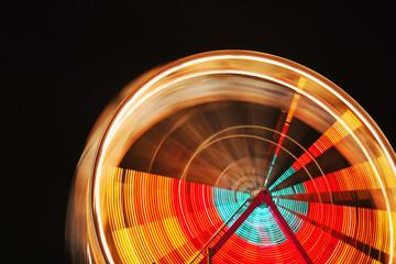 Motion blurred ferris wheel at a county fair.