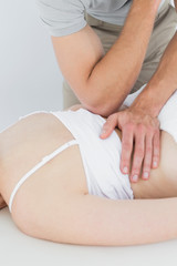 Physiotherapist massaging a womans back