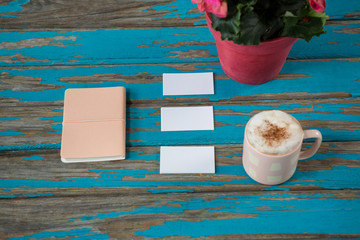 Coffee with diary and sticky notes on table