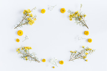 Flowers composition. Frame made of yellow flowers on gray background. Flat lay, top view, copy space