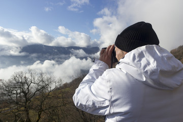 hiker takes picture of a mountain landscape