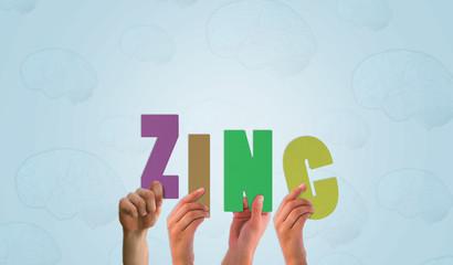Hands holding up zinc against blue brain pattern background