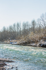 River in Winter. Rapids of Stormy River. Winter Landscape.