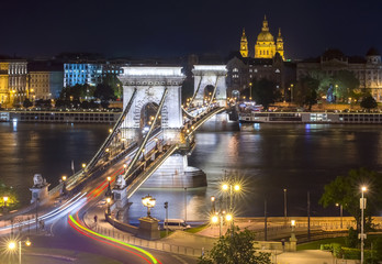 Chain Bridge over Danube river and St. Stephen's Basilica at night, Budapest, Hungary