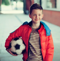 boy in red jacket with soccer Ball