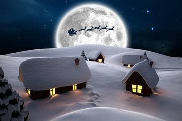 Snow covered houses against stars twinkling in night sky