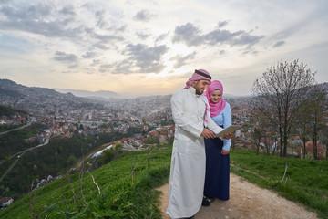 Muslim couple using tablet