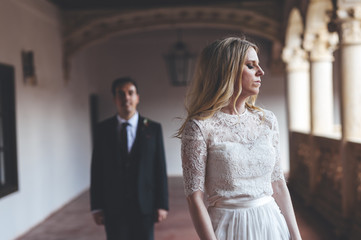 Portrait of bride breathing air close to her husband