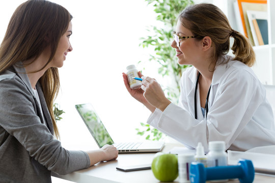 Female dietician prescribing nutritional supplement for patient in the consultation.