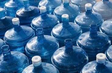big empty water bottles in a row