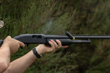 Firing Pump Action Shotgun