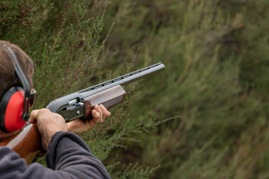 Aiming Shotgun At Skeet Tournament