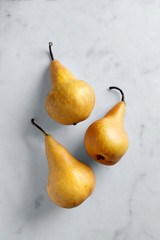 Fresh pears viewed from above on a marble background. Top view
