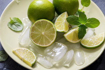 Lime and mint, ingredients for refreshing drink, lemonade or mojito cocktail,  healthy fruits
