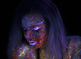 Portrait of Beautiful Fashion Woman in Neon UF Light. Model Girl with Fluorescent Creative Psychedelic MakeUp, Art Design of Female Disco Dancer Model in UV