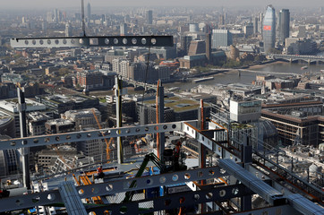A steel is craned into position on the AXA IM - Real Assets Twentytwo building in London