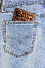 In the pocket of blue jeans inserted passport cover reptile leather