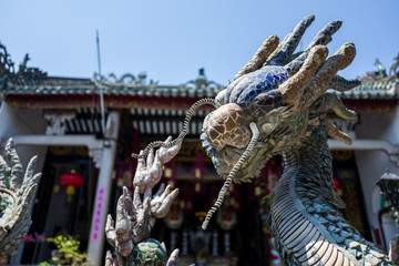 Dragon statue at temlle in Hoi An, Vietnam.
