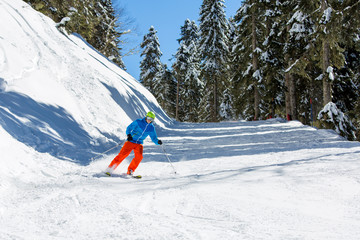 Photo of sports man skiing on snowy slope