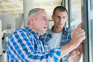 glazier giving lesson to his apprentice
