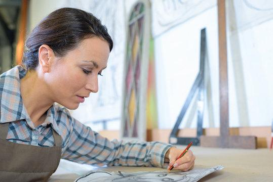 Left handed artist sketching