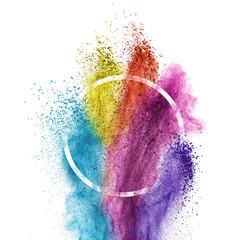 Splash of multicolor powder into circle frame isolated on white