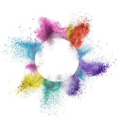 abstract multicolor powder splatted behind a round frame exploding on white background