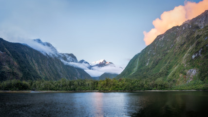Beautiful sunset color at Harrison Cove in Milford Sound, Fiordland National Park, New Zealand, South Island