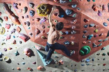man climber climbs indoors